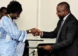 Bernard Padré à Gauche aux côté du Ministre Sénégalais de la Justice